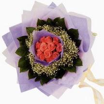 12 adet gül ve elyaflardan   Çankırı online çiçekçi , çiçek siparişi